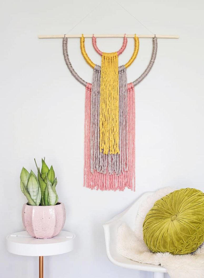 DIY colorful yarn wall hanging with catchy shapes (via abeautifulmess.com)