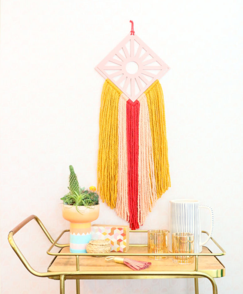 DIY colorful boho wall hangings with various plywood detailing (via akailochiclife.com)