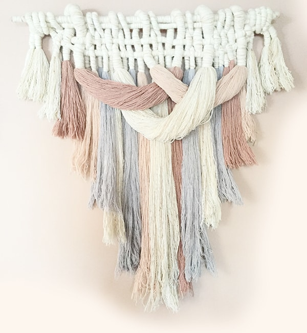 DIY pastel mop head wall hanging with yarn (via cuckoo4design.com)