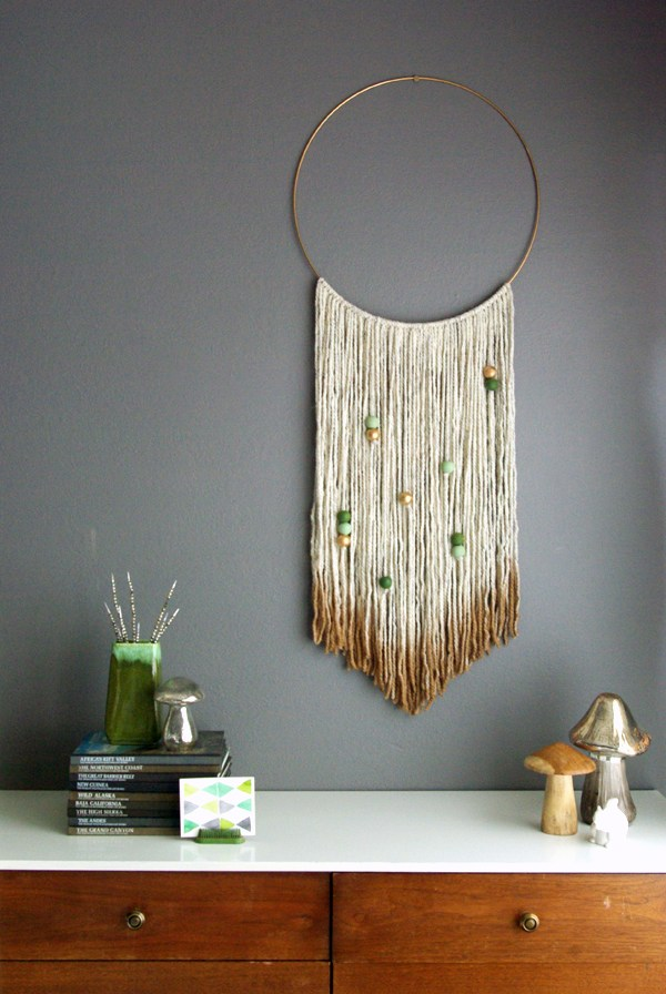 DIY gold dipped yarn hanging with wooden beads (via oleanderandpalm.com)