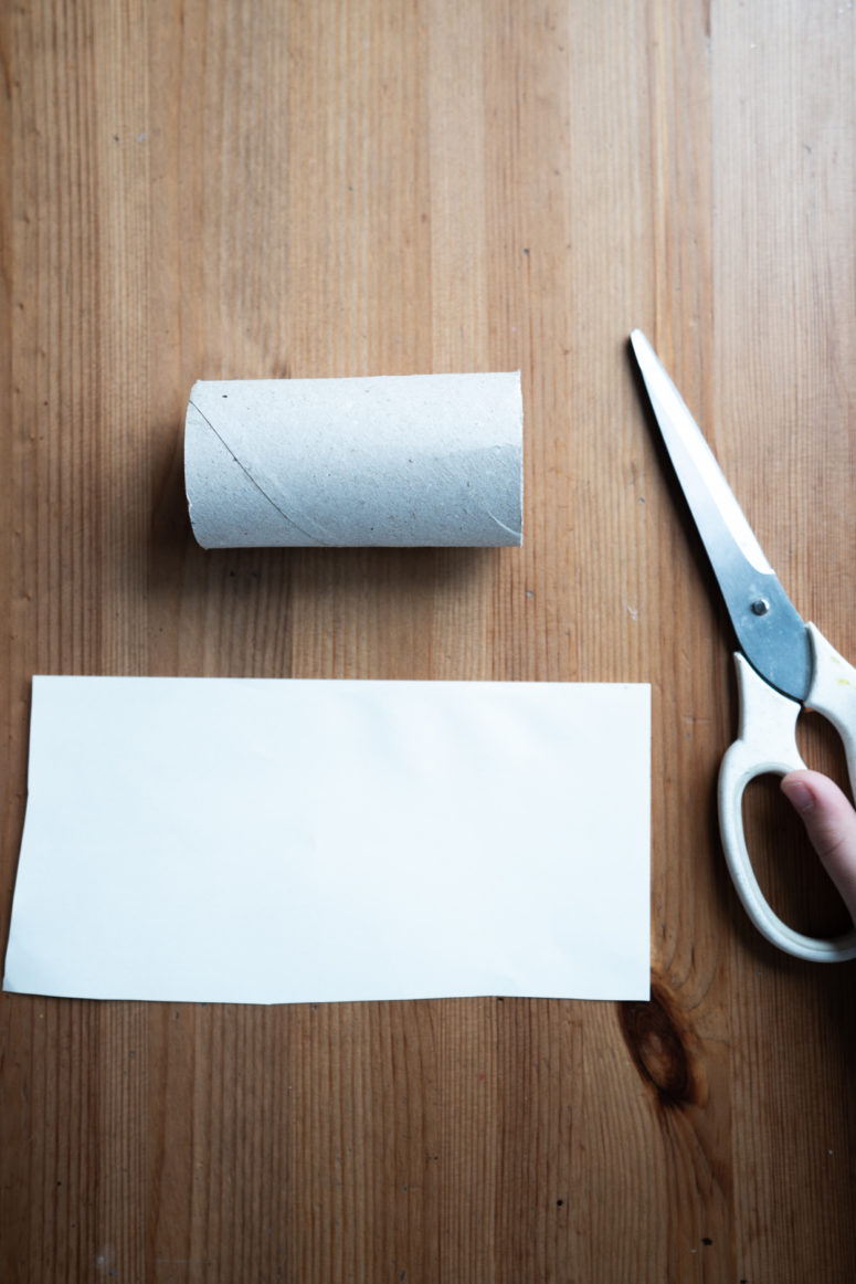Measure out light beige paper and glue it around the roll.