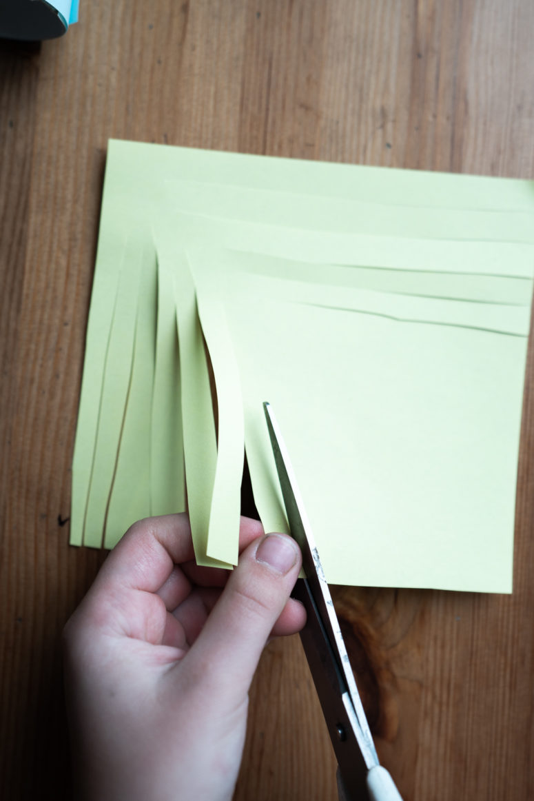 For hair, you'll need two thin strips and a square of yellow paper.