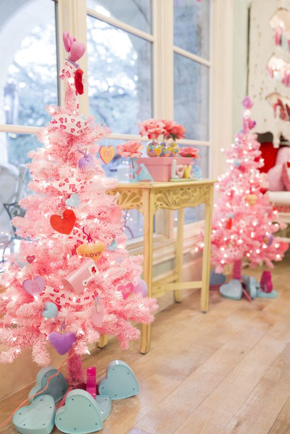 mini Valentine trees in pink with heart ornaments and conversation hearts, lights and heart print ribbons