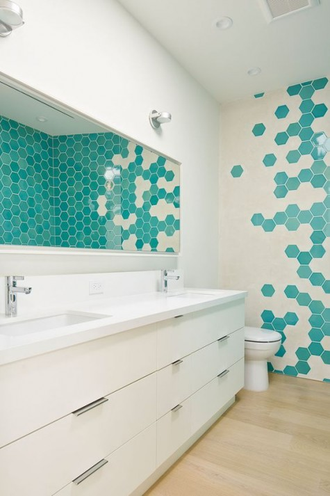 cream and turquoise hex tiles on the wall create a bold mosaics that makes the space unique and eye-catching