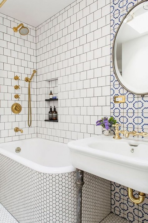 neutral tiles – square ones and penny hex tiles plus an accent with blue and white mosaic tiles over the sink