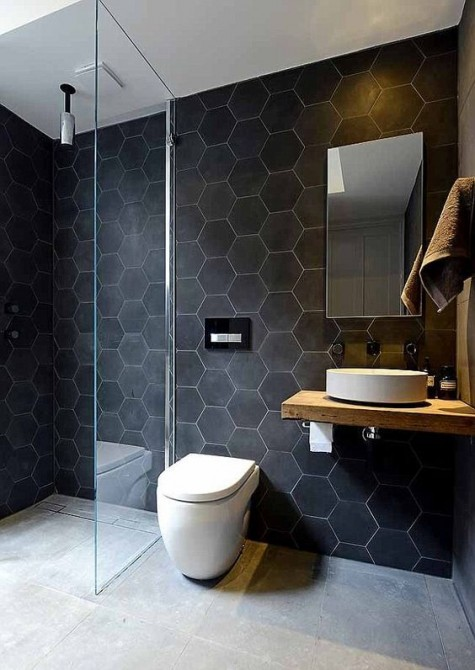 large scale matte black hexagon tiles with white grout make the walls bold and outstanding