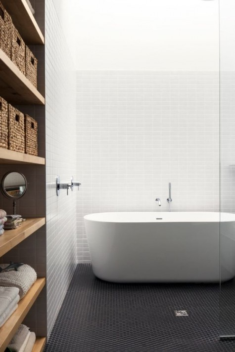 black penny tiles contrast white ones on the walls creating a monochromatic yet very eye-catchy space