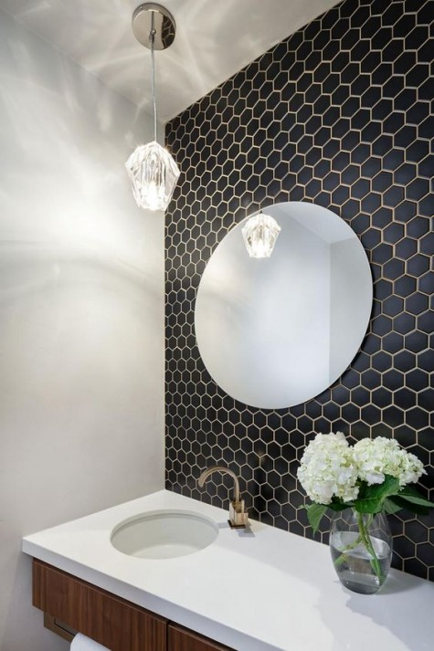 small black hex tiles with brass grout and a matching faucet to create an elegant and refined look in the sink zone