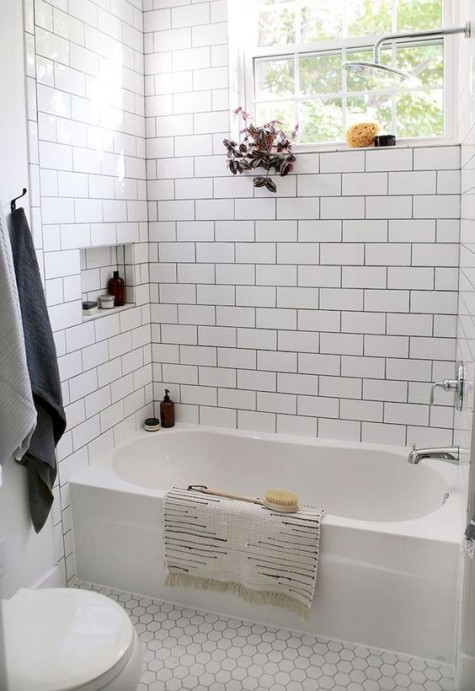 white tiles – subway ones on the walls and hex penny tiles on the floor accented with black grout