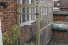 07 a small cat enclosure for a balcony – a wood and chicken wire construction plus some furniture inside