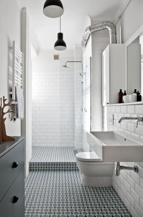 a bold mosaic tile floor and walls done with white subway tiles for a contrast and a catchy look