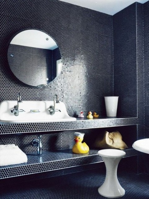 black penny tiles all over the sink zone covering the vanity itself for a unique look