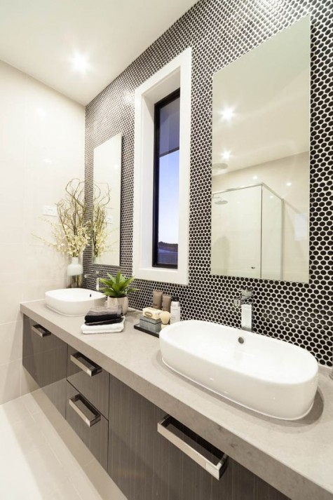 black penny tiles with white grout look bold and eye-catchy and contrast the white items here