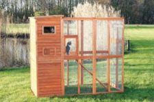 10 a comfortable outdoor cat enclosure with an open space to enjoy grass and a closed shelter-like space to hide there