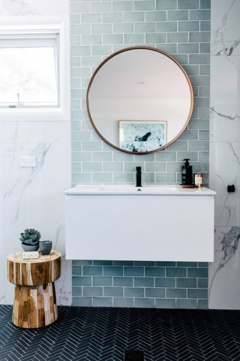 a sink space highlighted with mint green subway tiles look cool and chic, it refreshed the whole space