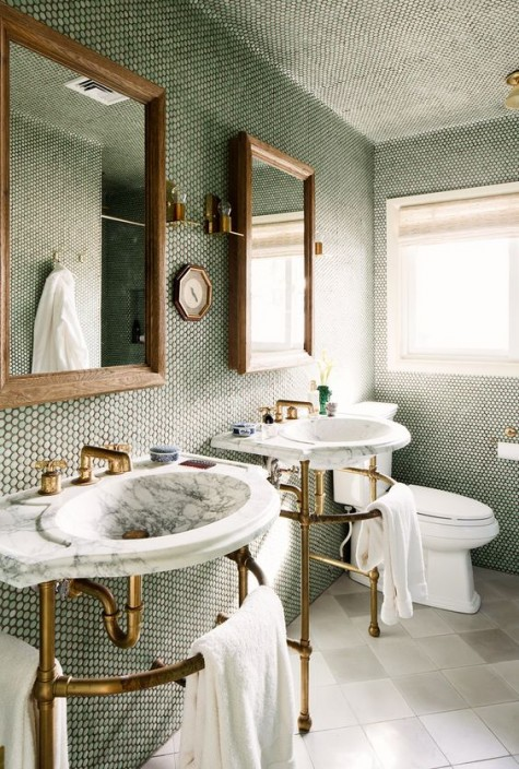 green marble penny tiles with black grout, brass fixtures and wooden frames for a bold look