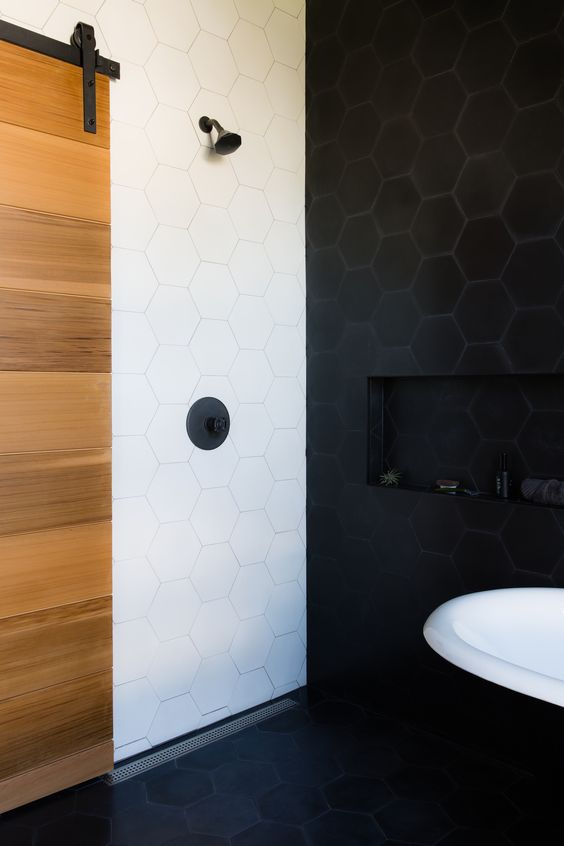 a super bold combo of black and white hexagon tiles with matching grout for a contemporary space