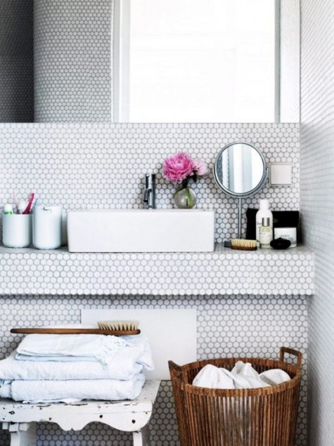 white penny tiles in the sink zone make it eye catchy and very modern, the grout matches for a harmonious space