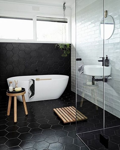 black hexagon tiles with white grout and white subway tiles create a bold contrasting look