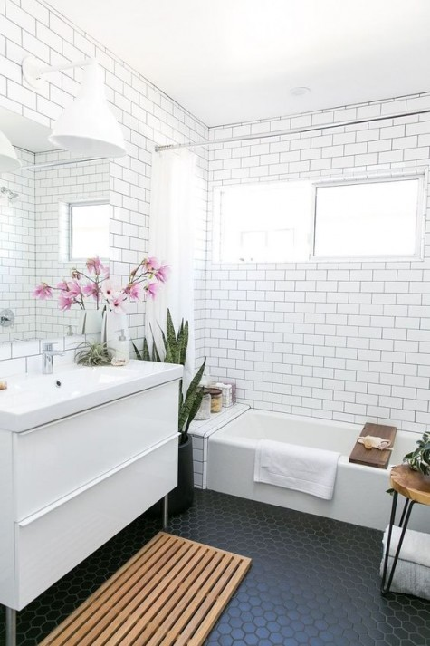 black hex penny tiles and white subway tiles create a bold combo for a contempprary bathroom