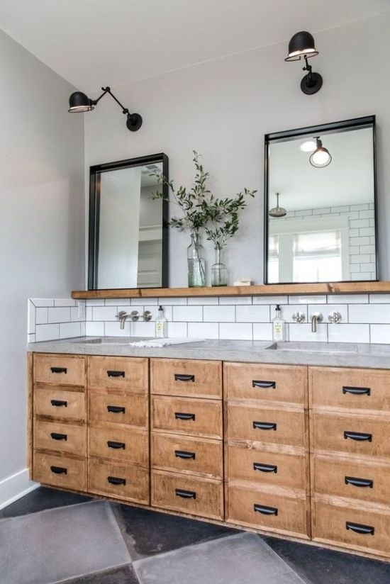 white subway tiles with black grout, a concrete countertop and a plywood vanity with drawers