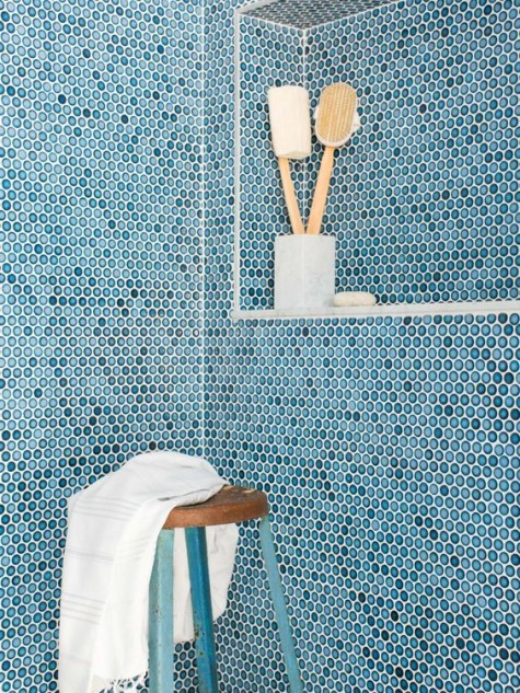 blue penny tiles with white grout will make your shower space look very seaside or coastal