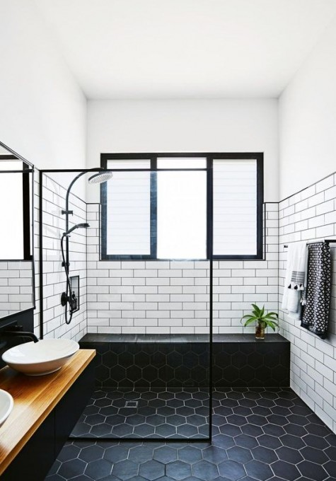 catchy black hexagon tiles on the floor and white tiles on the walls accented with black or white grout for an outstanding look