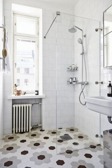 hex tiles showing off a floral pattern and white tiles on the walls to contrast them and make the space more neutral
