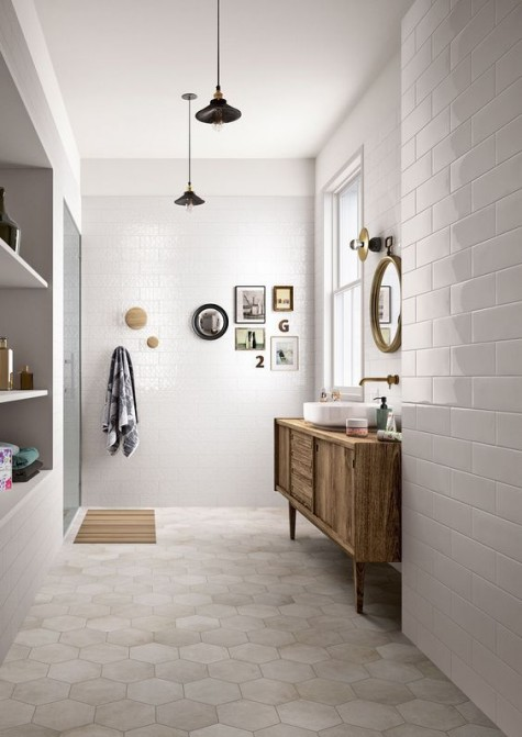 neutral hex tiles on the floor and white subway tiles on the walls create a peaceful and welcoming space