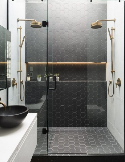 black hex tiles with white grout make the shower zone stand out in the neutral bathroom