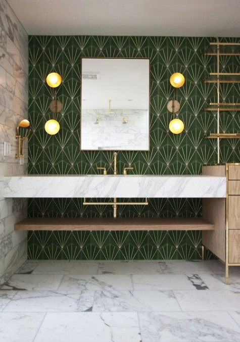 bold green and gold art deco tiles on the walls and white marble ones on the floor