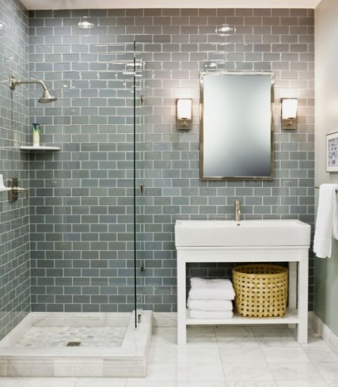 grey and slate subway tiles contrast marble floor tiles and create a chic and welcoming bathroom space