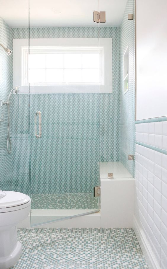 turquoise penny tiles with white grout in the shower space make the bathroom look bolder