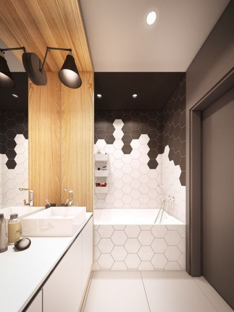 white and black hexagon tiles clad in a catchy and bold pattern to highlight the bathtub zone