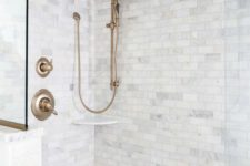 23 a shower space done with marble tiles and marble penny tiles plus copper fixtures for a vintage touch