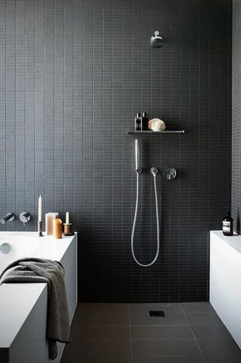 catchy small black tiles on the walls give your bathroom a sexy feel, and grey tiles on the floor