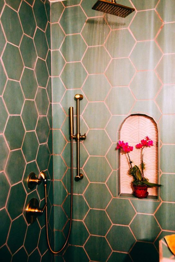 green hex tiles paired with copper grout and copper fixtures are a chic and bold idea wiht a refined touch