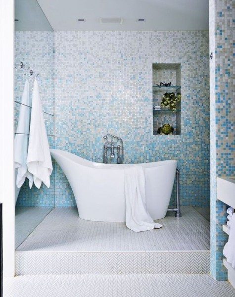 little colorful tiles creating a catchy pixel pattern and neutral herringbone tiles on the floor