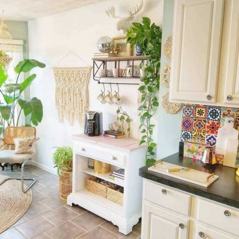 a boho chic kitchen spruced up with macrame, jute, wicker and a colorful tile backsplash for a free spirited feel