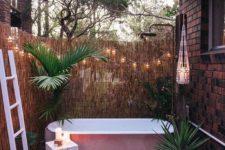 a cool boho outdoor bathroom design