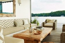 a neutral coastal terrace with a driftwood mirror, a wooden table and sleek minimalist furniture