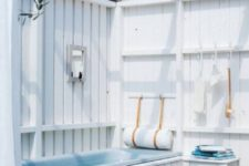 a cool sea-inspired bathroom design in white tones