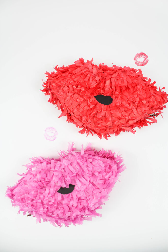 DIY colorful Valentine lip pinatas (via letsmingleblog.com)