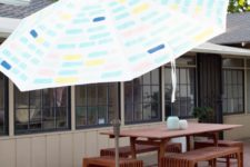 DIY painted patio umbrella with modern patterns