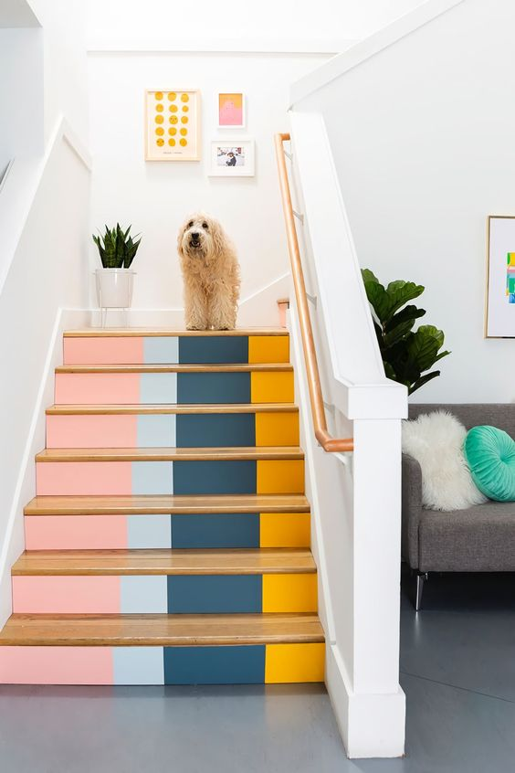 a bright color block staircase will give much color to the space and hint on the mid-century modern style