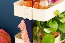 02 a simple IKEA Raskog hack with colorful yarn for a boho feel is a cool mobile bar that will fit a boho space
