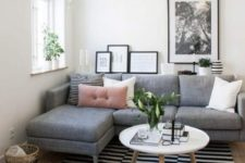 02 a small living room with a grey sectional sofa that takes most of space yet fulfills its function and a coffee table