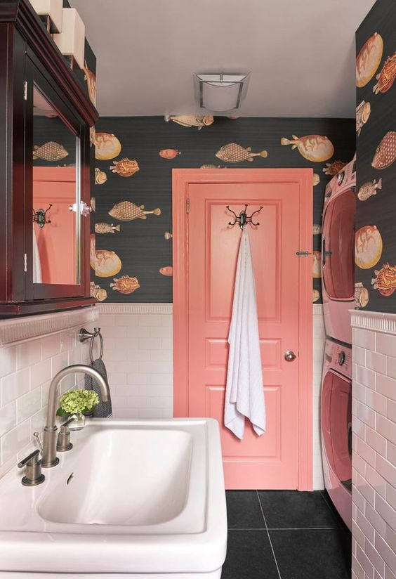 add a touch of whimsy with fish print wallpaper in your bathroom, here it matches the coral door perfectly