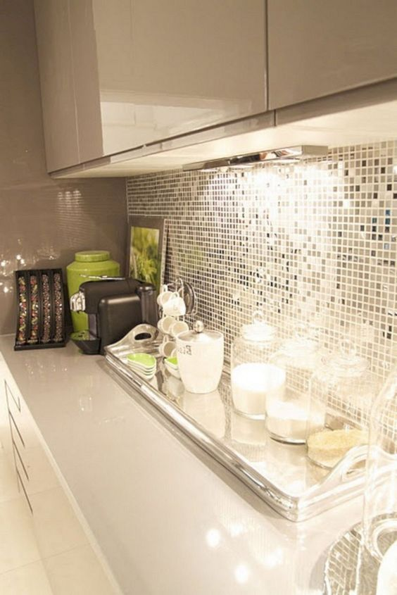 an extra shiny kitchen backsplash with small silver tiles and neon green touches for a bold look