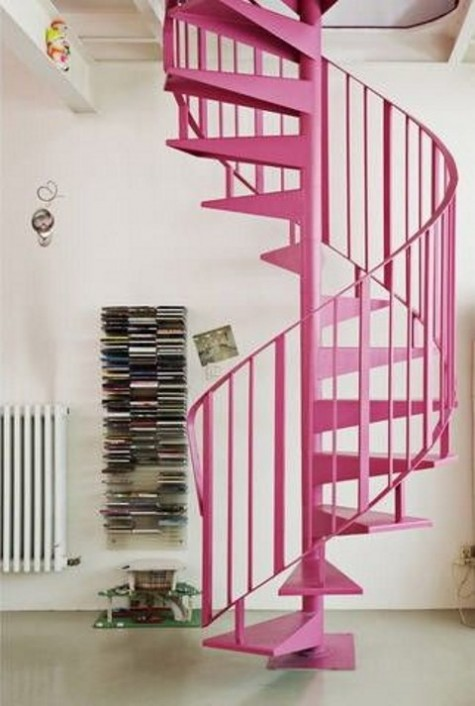 a bright pink metal spiral staircase is a cool color statement that nobody expects to see in your home